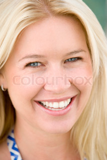 Image of 'smiling, woman, one person'