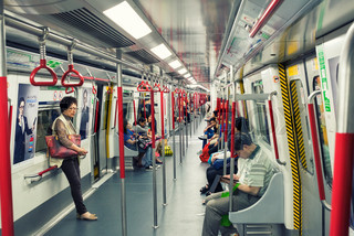 HONG KONG - APRIL 22, 2014: Riders on the MTR in Hong Kong, China. In 2012 the MTR reportedly had 46.4% of the public transport market, making it the most popular transport in Hong Kong.