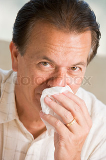 Image of 'man, cold, blowing nose'