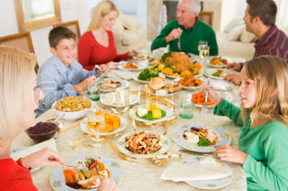 A caucasian family enjoying their  Christmas dinner