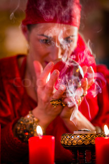 Soothsayer in Seance with Crystal ball and smoke