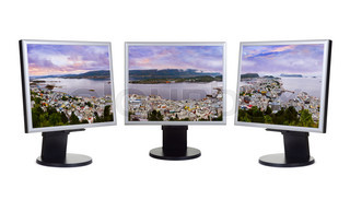 Panorama of Alesund Norway in computer monitors
