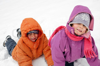 two 5 year old children playing in snow