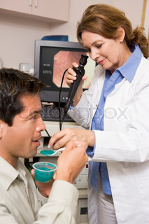 Doctor Performing Check-Up On Patient