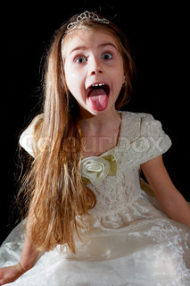 portrait of a 5 year old girl with het tongue sticked out