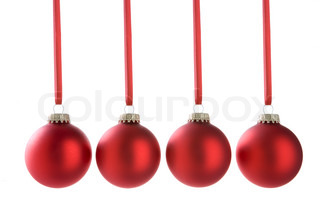 christmas; xmas; decorations; baubles; festive; noel; holiday; red; christmas tree; group; line; hanging; ribbon; cut out; studio; horizontal
