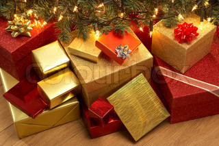 Group Of Christmas Presents Under Tree
