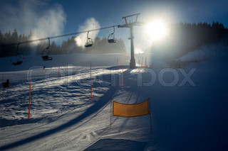 landscape of ski slope with chairlifts at sunny day