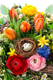 easter bouquet with egg decoration. spring flowers tulip, ranunculus, hyacinth