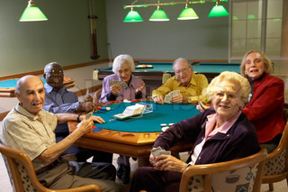 Senior adults playing bridge