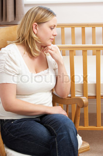 Image of 'woman, sad, miscarriage'