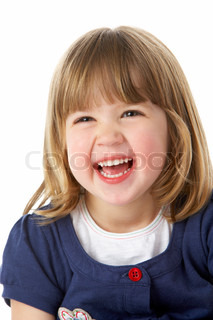 Studio Portrait Of Laughing Young Girl
