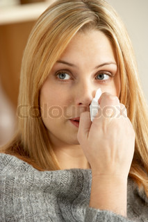 Young Woman With Cold Blowing Nose