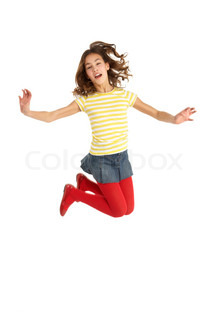 Mid Air Studio Shot Of Young Girl Jumping In Air