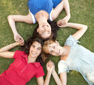 Group Of Teenager Girls Looking Up Into Camera