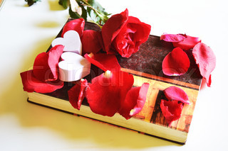 Roses on old books and small heart, vintage style