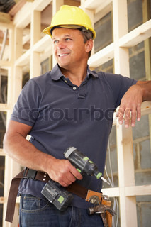 Construction Worker Building Timber Frame In New Home