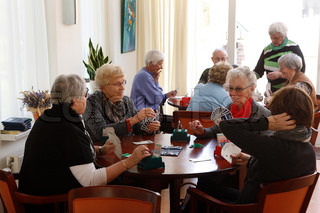 elderly people playing the game of cards