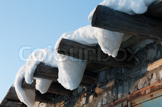 Wooden roof, drooping snow, winter, sunny, blue sky