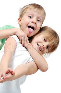 happy 5 year old girl and boy over white background