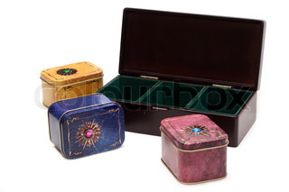 Box with tea, iron packing, decorated stone on white background