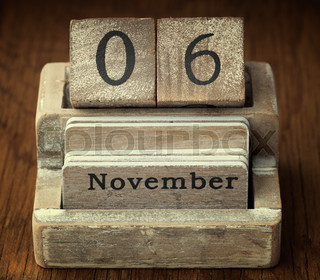 A very old wooden vintage calendar showing the date of 6th November on wood background