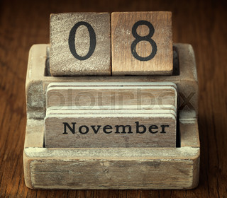 A very old wooden vintage calendar showing the date of 8th November on wood background