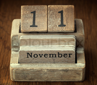 A very old wooden vintage calendar showing the date of 11th November on wood background