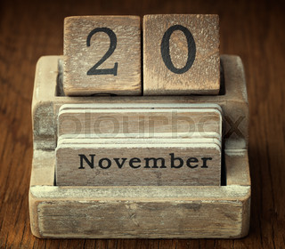 A very old wooden vintage calendar showing the date of 20th November on wood background