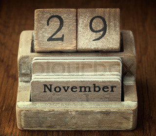 A very old wooden vintage calendar showing the date of 29th November on wood background