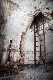 Old abandoned empty bunker interior with stairway