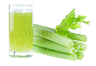 A glass of fresh celery juice isolated on white background