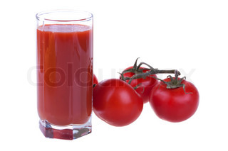 Glass of fresh tomato juice with tomatoes isolated on white background