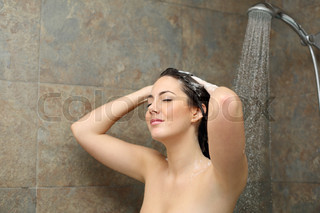 Woman showering cleaning her hair with soap in the shower