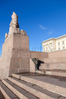 Granite sphinx. Old monument on blue sky