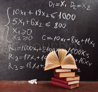 Mathematical equation. Chalkboard with books