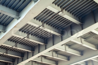 Abstract gray steel construction with beams and bolts