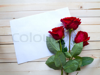 Red roses on a wooden table
