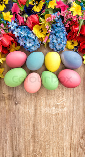 Spring flowers and colored eggs. Easter decoration