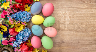 Easter decoration with spring flowers and colored eggs. Holidays background
