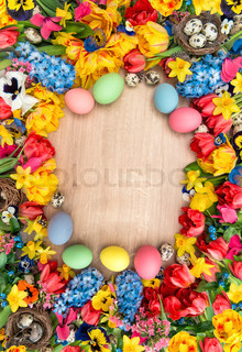 Easter decoration with spring flowers and colored eggs