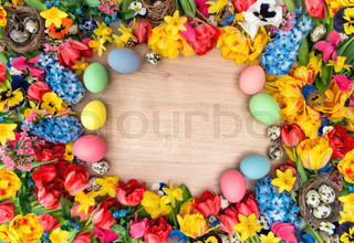 Easter decoration with tulips, narcissus, hyacinth flowers and colored eggs