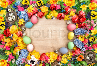 Holidays background with spring flowers and easter eggs. Tulips narcissus