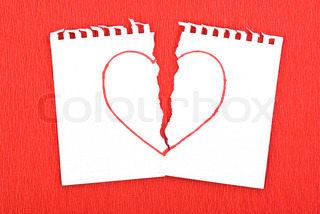 Heart drawn on torn notebook page on red background
