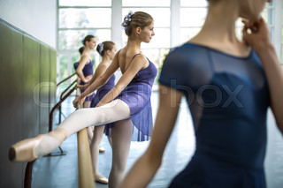 Group of five young dancers trained in a dance class near the ba