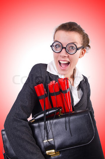 Businesswoman with dynamite on white