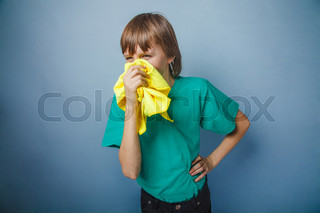 Boy, teenager, twelve years in a green t-shirt , handkerchief