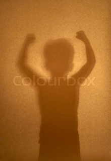 silhouette of boy demonstrating his muscle