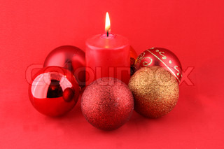 chrismas still life with red candles and balloons