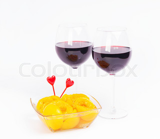 Red wine valentine glasses with peaches
